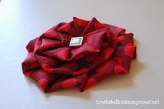 Pleated fabric flowers tutorial.  How cute!  Would make a great embellishment for a simple top.