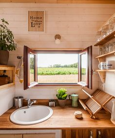 The kitchen has a sink, stove, and a fold down dining table that can be stored away when not in use. The owners are vegetarians and only wanted a small sandbox to keep vegetables cool instead of using a refrigerator.