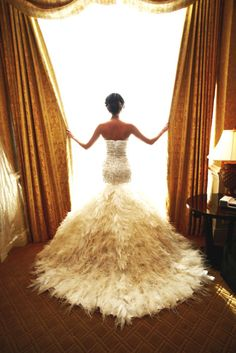 wedding dress #feathers #train I like it its different totally out of the box of what I would normally pick