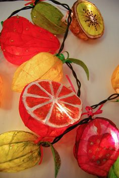 fairy lights made from papier mache fruit and veg.  Joanna Coupland