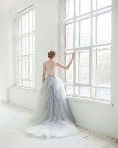 Cascading layers of blue and icey gray tulle by @ca.rousel_official #weddingdress #dressinspiration #bride #weddinginspiration