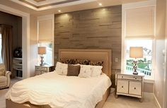 Wood slats give the bedroom accent wall an inviting warmth