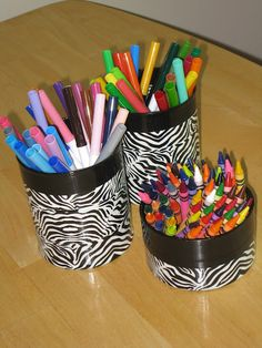 We do this with old containers to hold random things like pencils, markers, make up brushes...etc. I luv my duct tape!!!
