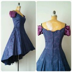 This vintage 1980s purple prom gown is super with its hi lo style and scalloped off shoulder cut. Its available right now at TwoVintageLadies!