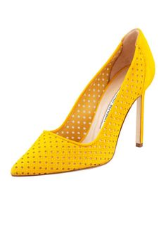 The hottest summer sandals: Manolo Blahnik yellow perforated suede pumps