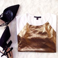✨Closet Clear out✨Urban Outfitters Top Gold sleeveless top, the back is white. Perfect for a casual party. Urban Outfitters Lucca Couture brand. No tags never worn. Clearing out my closet make an offer!✨ Urban Outfitters Tops Muscle Tees