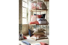 Throw pillows to dress up any space! Love the coral and blue!