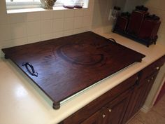 Cooktop cover.....plywood, spindles, stain and inspiration!