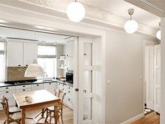 those pocket doors!!! horseshoe kitchen layout with glass pocket doors via DecorPad