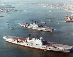 "apostlesofmercy: ""HMS Eagle lay at anchor awaiting the breakers yard as her sister Ark Royal passes by - circa "" Royal Navy Aircraft Carriers, Navy Carriers, British Aircraft Carrier, Hms Ark Royal, Navy Day, Capital Ship, Naval History, British History, Military History"