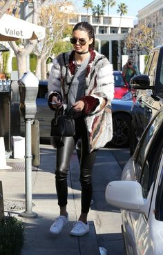Kendall Jenner wearing Saint Laurent Classic 11 Aviator Sunglasses, Kenneth Cole Kam Sneakers, Cartier Juste Un Clou Bracelet, Givenchy Lucrezia Micro Bag and Elizabeth and James Tarra Fur Coat