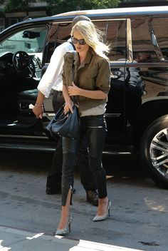 Rosie Huntington-Whiteley steps out in leather zip pants, pointed toe heels, khaki military jacket and a black cross body bag.