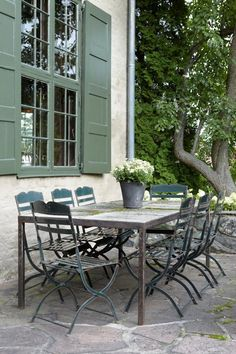 Oslo House | Heiberg Cummings - Love the rustic table with the pop of color on the chairs... very European bistro.