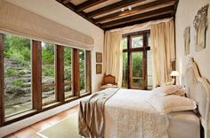 big windows, green garden view, tile, exposed wood, off-white appointments