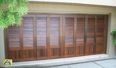Paint or dark stain. Specially made louvered Country House doors are one-of-a-kind and deliver an unparalleled elegance. This particular 16x6'9 door in Huntington Beach was made ...