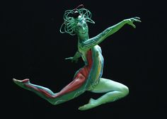 A model jumps as she poses during the annual World Bodypainting Festival in Poertschach