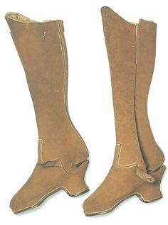 Queen Elizabeth I's riding boots. The close fit shows how slim her legs were. Tan suede with a complex chopine-type foot. Thick soles.