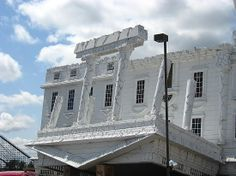 """This Wisconsin Dells attraction is """"Top Secret"""". Resembling an upside down White House, visitors are cautioned that this attraction is not for the faint of heart."""""""