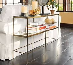 "Leona Console Table | Pottery Barn Overall: 48"" wide x 12"" deep x 30"" high Brass/mirror/glass shelves $599"