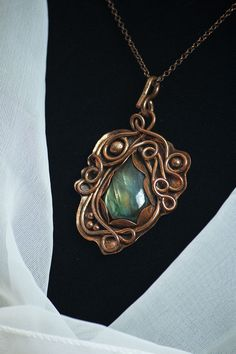 This unique, elvish styles necklace is made entirely from upcycled cooper and beautiful labradorite cabohon with yellow- green shine. Inspired by elves and nature, created with love, passion and attention to every detail and it is fantastic addiction to every outfit. It is true eye catcher!  ___________________________________________________  Metal: copper - recycled wire, sheet, beads and chain Stone: Labradorite cabochon Weight: 28.54 grams Size of the pendant: High: 2 1/2 inch (6.5 c...