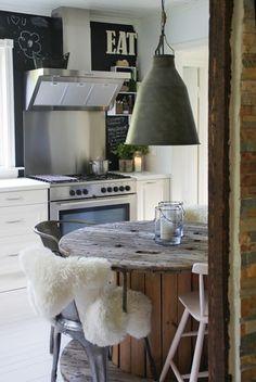 Scandinavian Modern kitchen. Lambskin on chair.