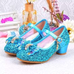 What little girl doesn't want to be a princess? These blue Frozen Princess Elsa inspired beautiful bling glitter sparkle girls shoes are perfect for any outing. The pearl bow and crystal embellishments add so much flair to this already gorgeous shoe. Perfect for Special Occasions all year round. *Also available in Gold
