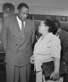 Actor, singer, and civil rights activist Paul Robeson speaks with  fellow activist and California Eagle editor and publisher  Charlotta Bass. Both Paul Robeson and Charlotta Bass  were accused of disloyalty by the Committee of Un-American  Activities and were the subjects to federal investigations.