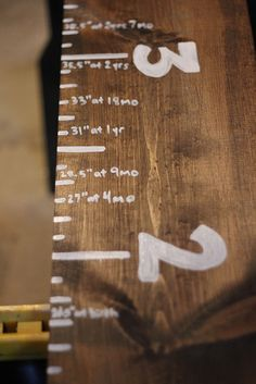 wooden growth chart that's written on...