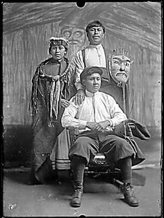 """Portrait of three Kwakiutl Indians, one in traditional dress, two in Western dress,"" Ben Leeson, 190-"
