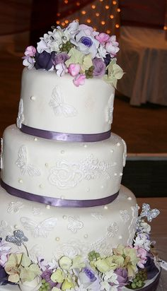 Three tier cream and purple wedding cake by elizabethscakeemporium, via Flickr