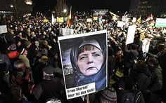 Merkel threatens WAR if countries oppose Muslim invasion and close borders - Whose ass is she nuzzling?