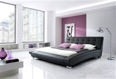 Classic black leatherette low profile bed to captivate your bedroom.
