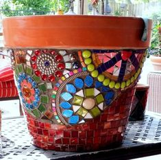 The bright colors and overlapping circles make this pot stand out.