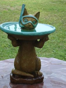 Cat bird bath. Prepared for bird landing. #gardenart #birdbath #funny