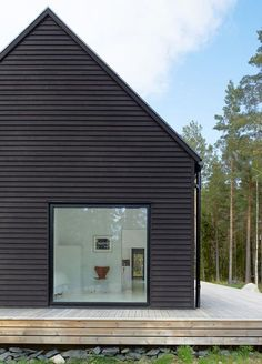 modern house with board and batten siding image from d w e l l. Black Bedroom Furniture Sets. Home Design Ideas