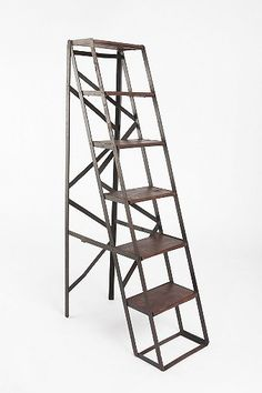 Considering getting this UrbanOutfitters' Folding Library Bookshelf to use as a decorative shelf until I have a home with 15' high bookshelves. Yes, I dream of libraries.