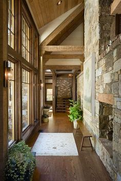 Craftsman Hallway with Exposed beam, Hardwood floors, Wall sconce, Oak - warm carmel solid hardwood plank, stone fireplace
