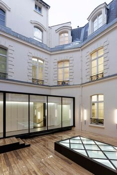 Italian studio Antonio Virga Architecte has renovated and extended a Parisian building to create offices and haute-couture workshops for French fashion house Dior Homme //