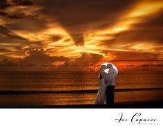 Naples Wedding Photographer Joe Capasso Photography - Marco Island Marriott Wedding Photographers.  Just Married through umbrella
