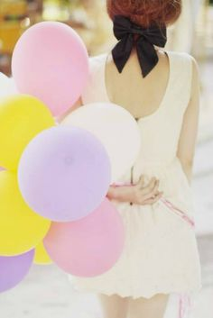 bow and pastel balloons