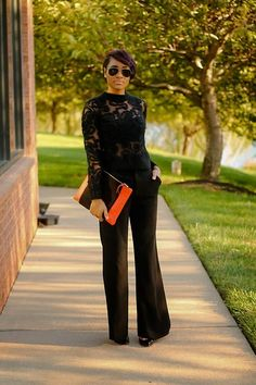 Black laced top with black trousers