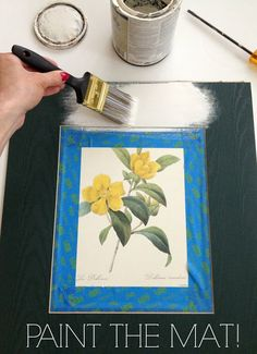 How to easily update outdated artwork from thrift store!  I found a botanical print that I loved at the thrift store and painted the outdated dark green mat white. I've mentioned before that I spray paint mats from thrift stores. But in case you don't have any spray paint or if you just don't have the right color, you can paint it by hand, too. I just used some tape to cover the print (which was previously glued to the mat) and used some leftover off-white interior paint.