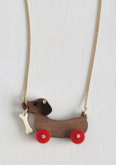 Kick, Woof, Coast Necklace. No matter how many wheels your favorite hobby happens to involve, this wooden dog necklace by Tatty Devine will roll along with you in retro style! #brown #modcloth