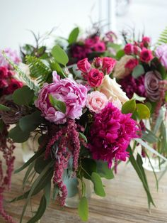Pink, cranberry, and ivory bridesmaids' bouquets | Whim Florals