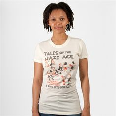 This is a soft cotton book cover women's t-shirt of Tales of the Jazz Age by F. Scott Fitzgerald. Purchase of this shirt sends one book to a community in need.