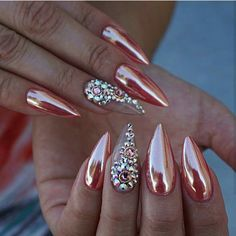 Rose gold chrome acrylic stiletto nails with rhinestone accent nail