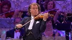 """André Rieu, over 500 brass players & the Johann Strauss Orchestra performing Nearer, my God, to Thee live in Amsterdam. Taken from the DVD """"André Rieu Gala-L. Gospel Music, Music Songs, My Music, Music Videos, Radio City Music Hall, Anthony Hopkins, Praise The Lords, Praise And Worship, Leonard Cohen"""