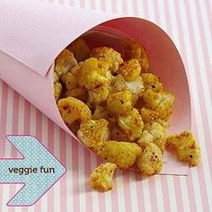 Cauliflower popcorn (Break a head of cauliflower into popcornlike, bite-size florets, then spread them on a baking sheet lined with parchment paper. Spray the cauliflower lightly with butter-flavor cooking spray, then sprinkle lightly with turmeric, freshly ground pepper, and sea salt. Bake 20 to 30 minutes at 425 degrees F or until the cauliflower is slightly browned.)