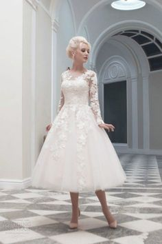 Wedding dress with lace sleeves. Absolutely love it, except for the line down the center of the back
