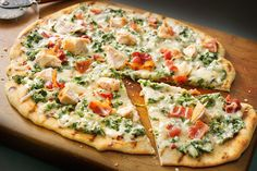 A cheesy mixture of bacon, chicken and spinach warmed in Alfredo sauce team up to make a great topping for this California-style grilled pizza.